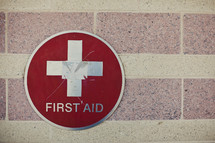First aid sign on building
