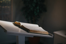an open Bible on a stand