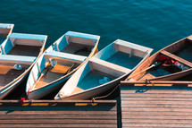 row boats at a dock