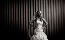 bride standing with her hands on her hips