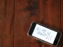 I love you dad on a cellphone screen