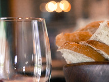 a bowl of bread and a wine glass