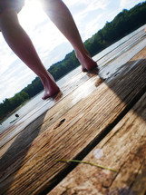 feet standing on a dock