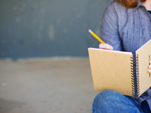 a teen girl writing in a journal