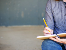 a teen writing in a journal