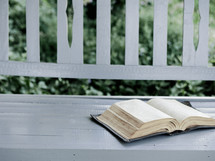 an old Bible on a front porch