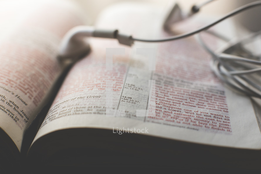 earbuds on a Bible