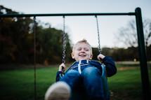 a boy on a swing