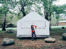 woman standing in front of a tent
