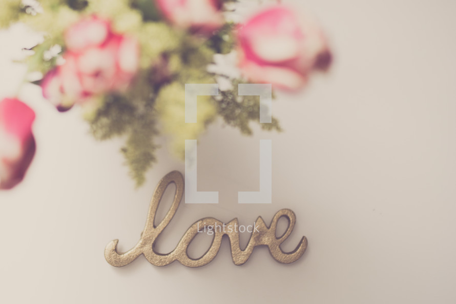 bouquet of flowers and word love