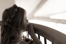 Girl peering over stairway