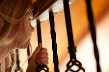 Peering through iron bars