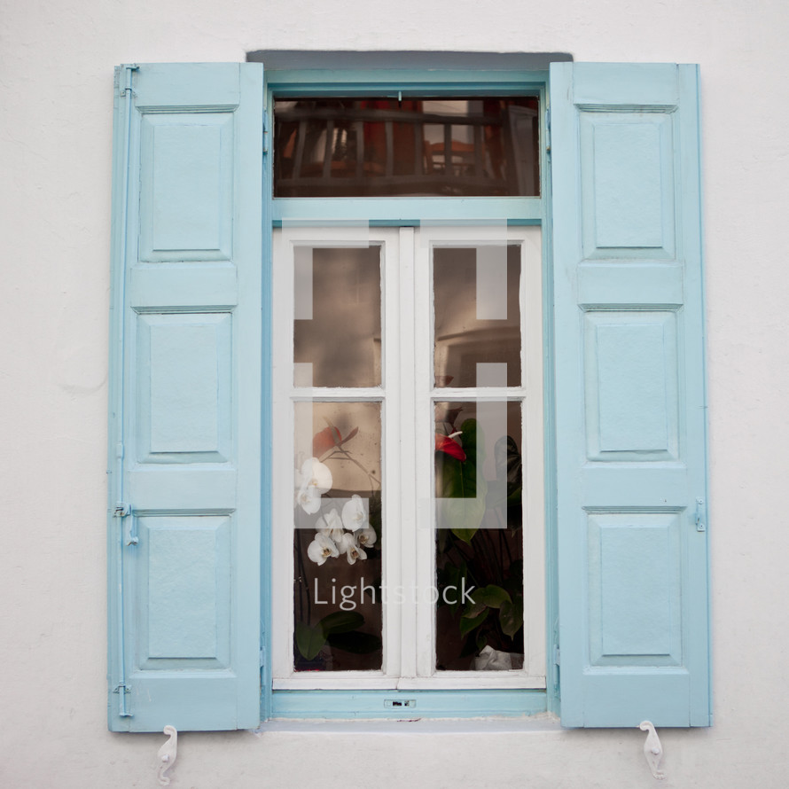 window with light blue shutters
