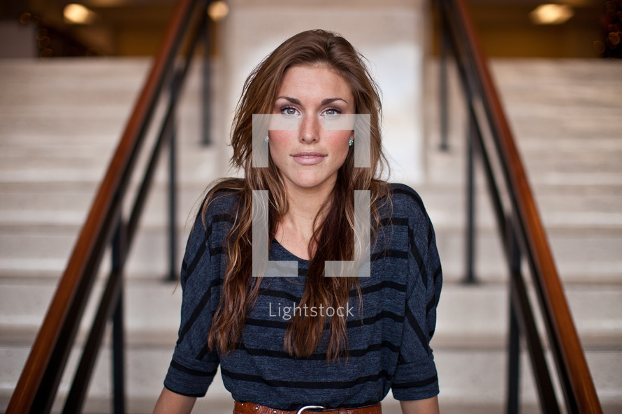 woman sitting on stair steps