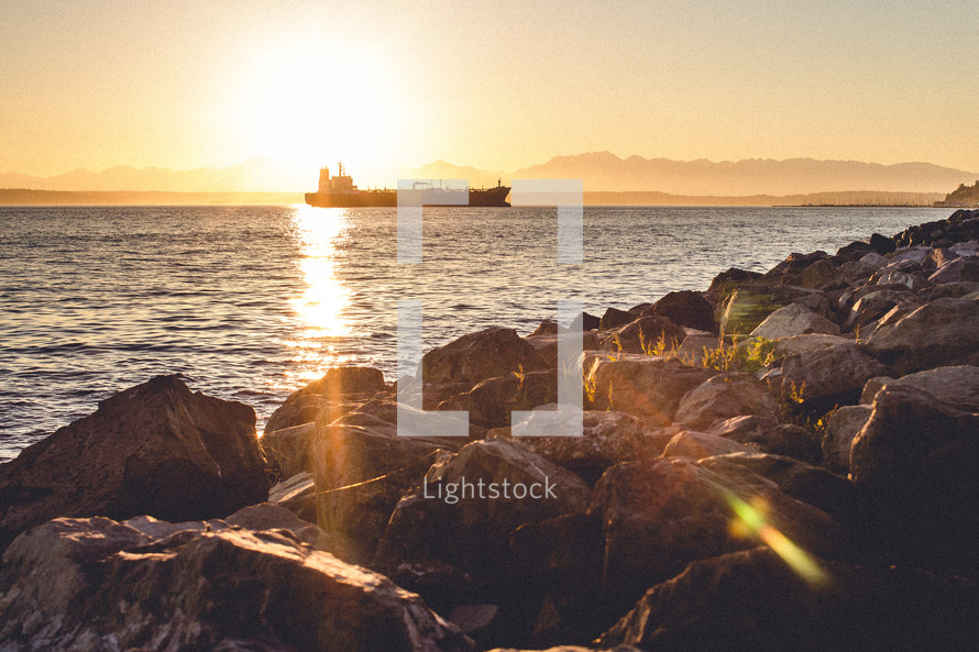Large ship on the ocean at sunset