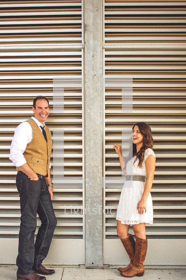 man and girl standing by metal wall