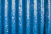 blue wall of a tin building