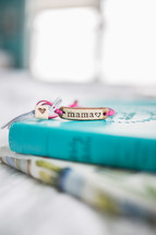 mama bracelet on a stacks of books