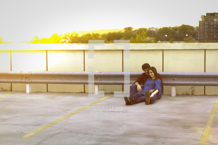 Happy couple outdoors on rooftop parking lot