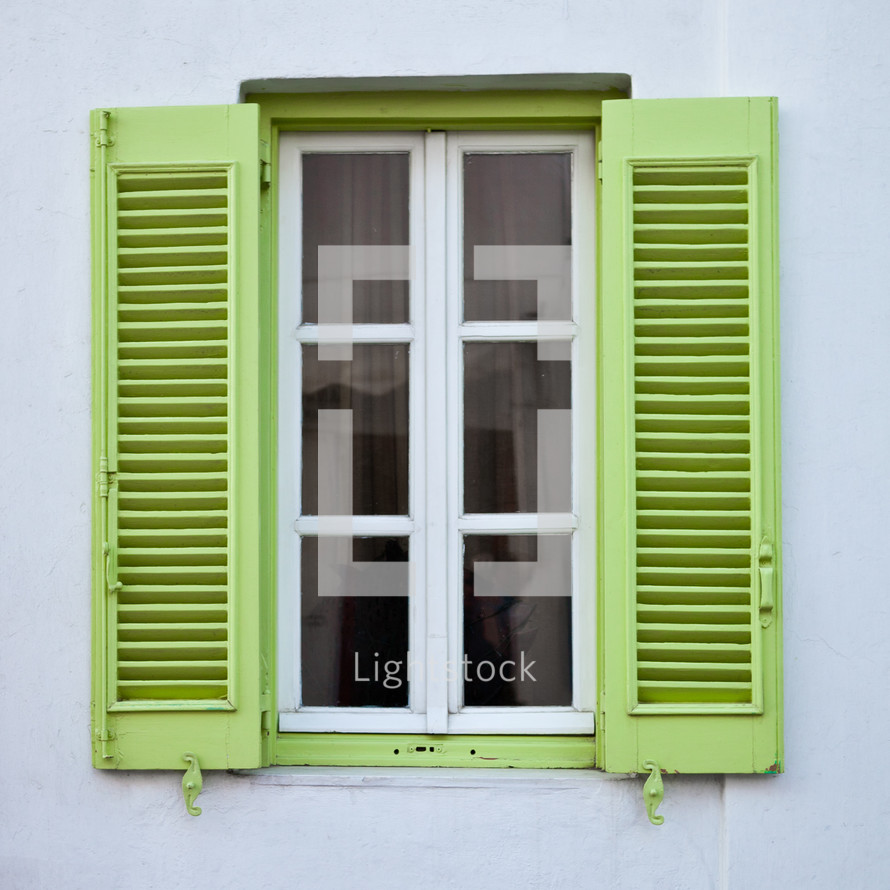 window with lime green shutters