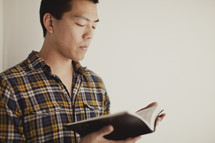 Asian man reading bible