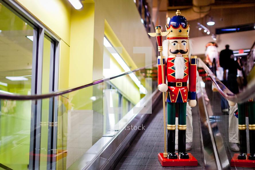 large Christmas nutcracker going down an escalator