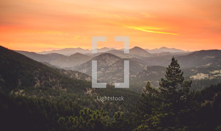 sky over a mountain range at sunrise