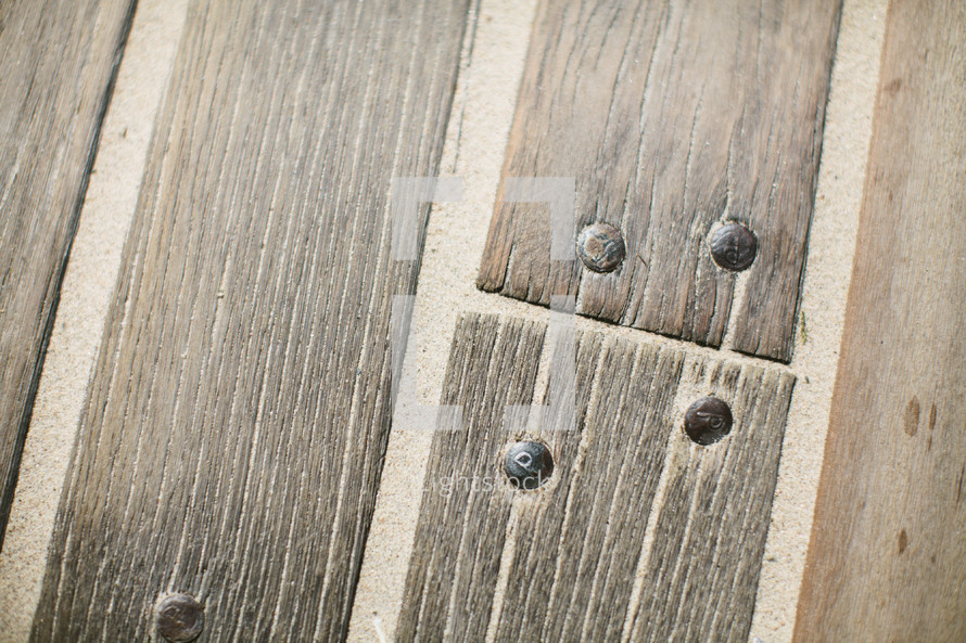 nails in wood planks