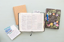 Who I am in Christ, notecards, prayer requests, open Bible, journal