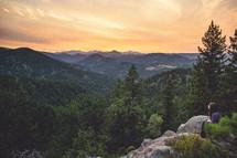 Sitting on mountaintop at sunrise