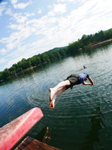 a man diving into a lake