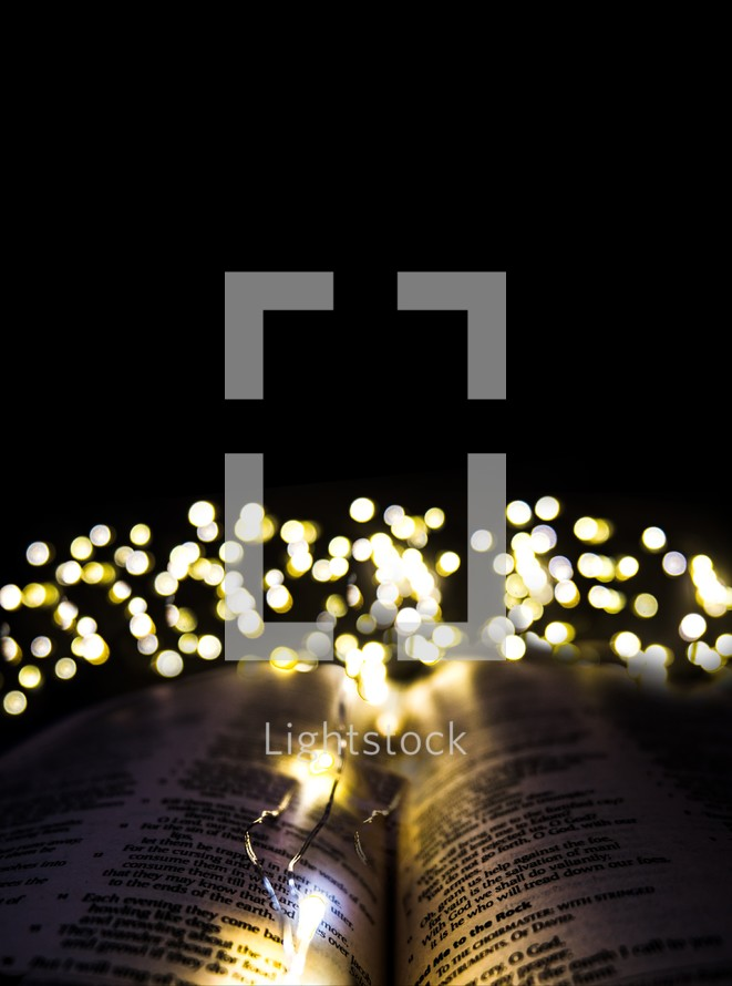 bokeh fairy lights over the pages of a Bible