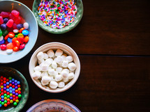 bowls of candy for decorating a gingerbread house at Christmas