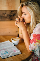 teen girl praying and an open Bible