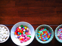bowls of candy for decorated a gingerbread house at Christmas