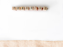word thankful on a white background and burlap border