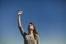Woman with raised hand