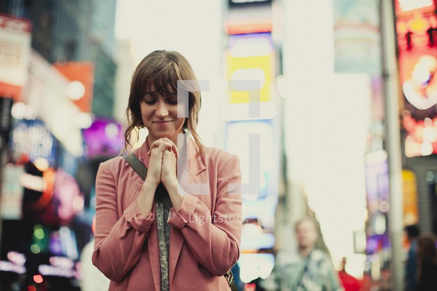 Woman praying in New York City