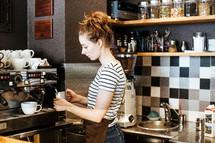 barista making coffee