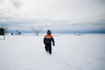 boy running in snow