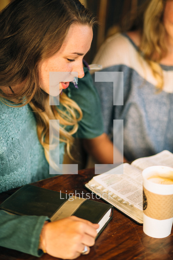 college students gathered in a coffee shop for a Bible study
