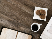 cookies, open Bible, and journals on a table for a Bible study