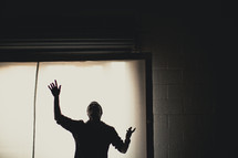 A man lifting his hand in worship