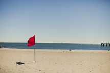 A red flag on the beach - no swimming