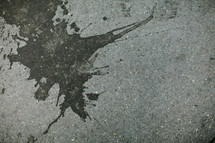 Tar splattered on concrete
