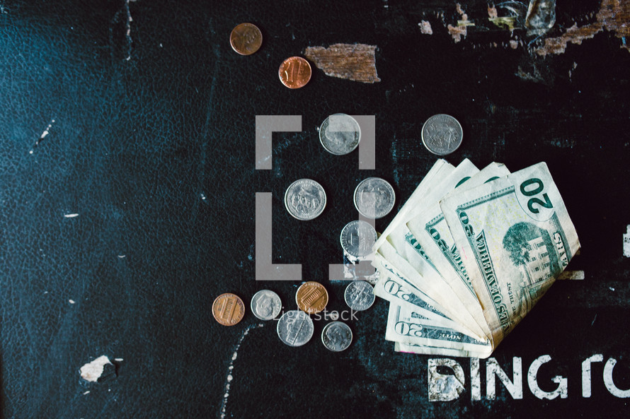 cash on a weathered surface