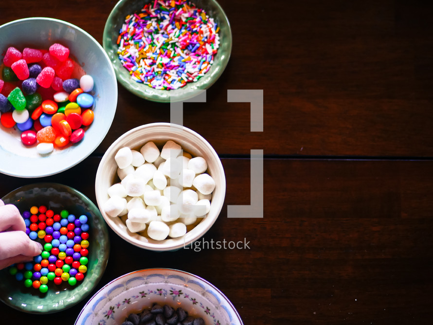 bowls of a candy for decorating gingerbread houses