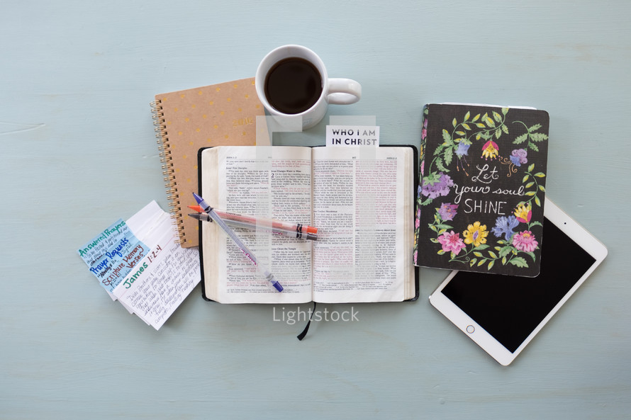 coffee, who I am in Christ, pages, open Bible, Bible, words, scripture, notecards, prayer requests, open Bible, journal, Bible study, prayer group