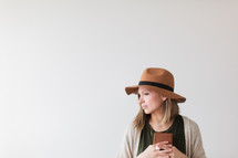 woman in a hat holding a Bible