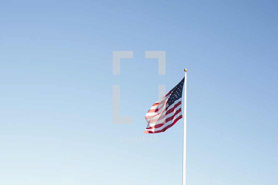 American flag flying on a pole.
